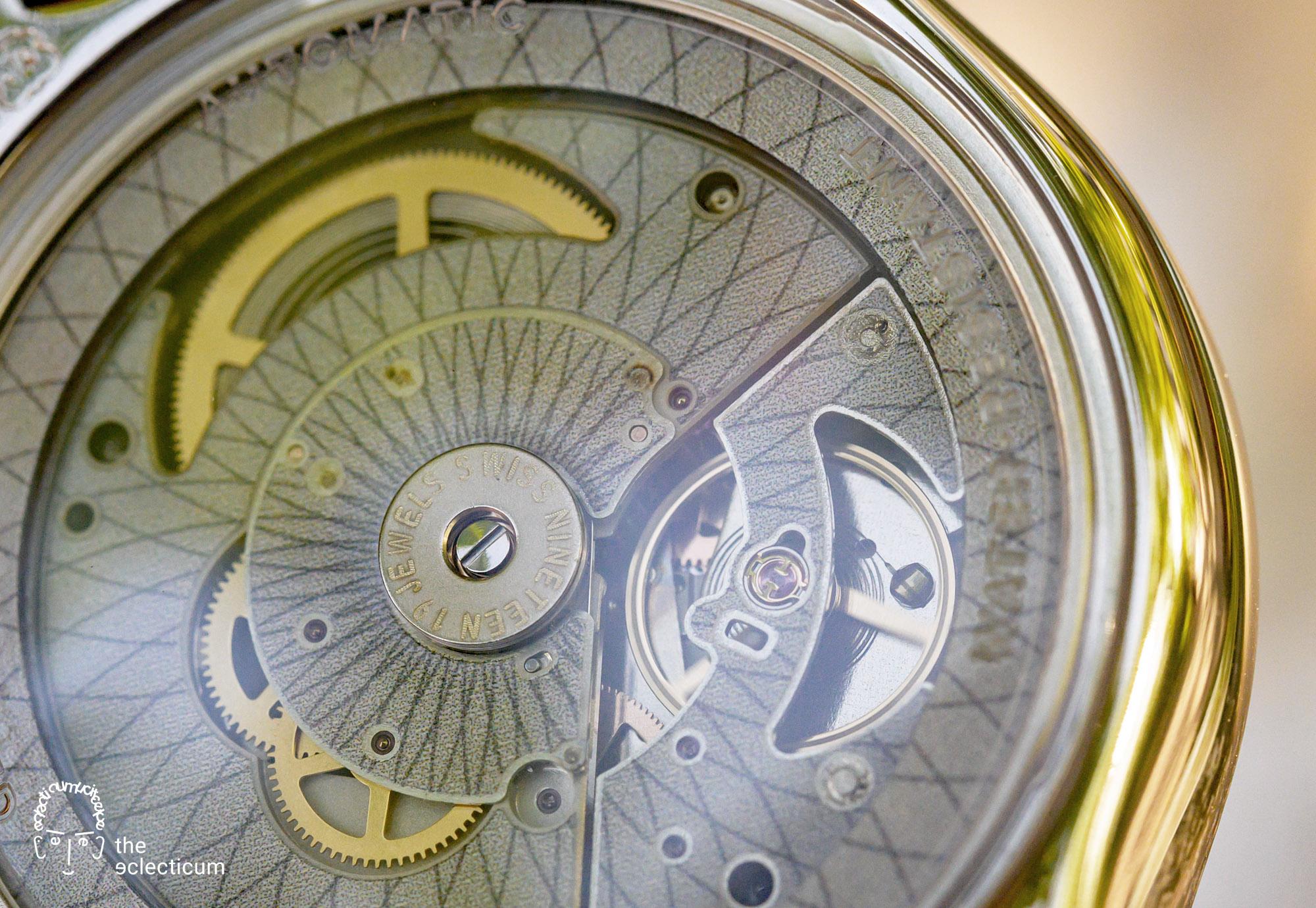 Swatch Sistem51 Petite Seconde automatic blue dial caseback ETA movement escapement