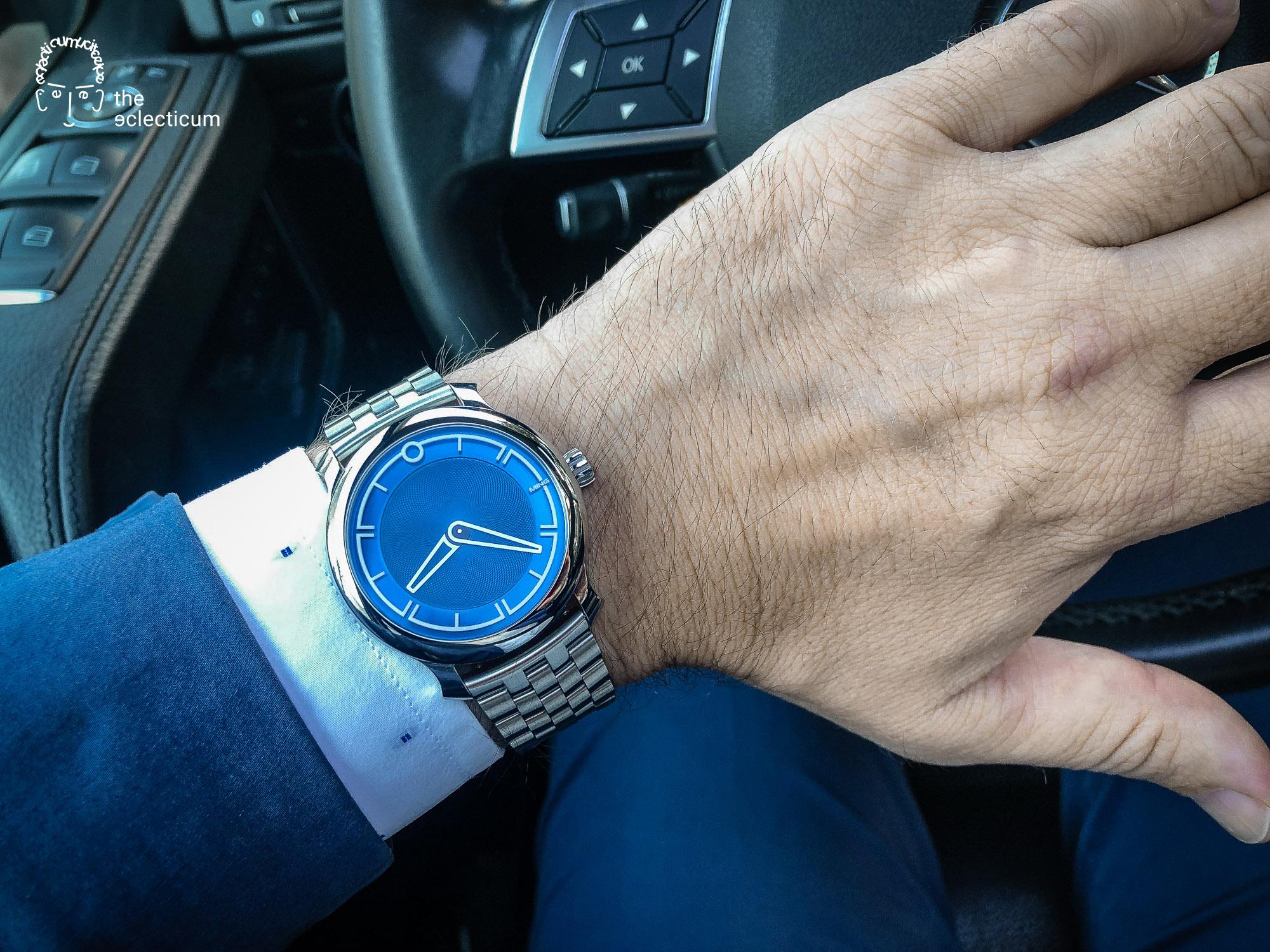 MING 17.09 BLUE on bracelet